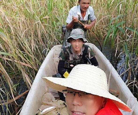 Shenghua in canoe at fieldsite
