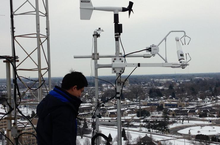 zutao working on urban flux tower